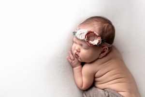 Custom Newborn Photo Shoot Augusta, Ga - Newborn baby girl with floral headband