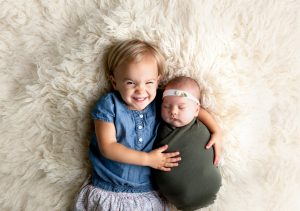 Sibling Newborn Photography in Martinez, Ga & Augusta, Ga - Baby girl and toddler girl posed together laying down