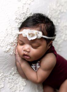 Newborn Photo Shoot in Martinez, Ga & Augusta, Ga - Newborn baby girl posed with burgundy outfit and white headband