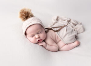 Newborn Photography in Martinez, Ga & Augusta, Ga - Newborn baby posed with bonnet and draped wrap