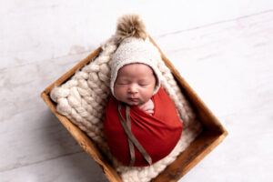 Baby wrapped up with bonnet - Newborn Photography in Augusta and Martinez Georgia